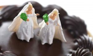 A set of lesbian wedding cake toppers