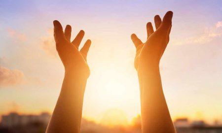 hands held up to heaven