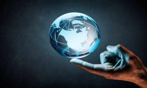 a hand holding the globe
